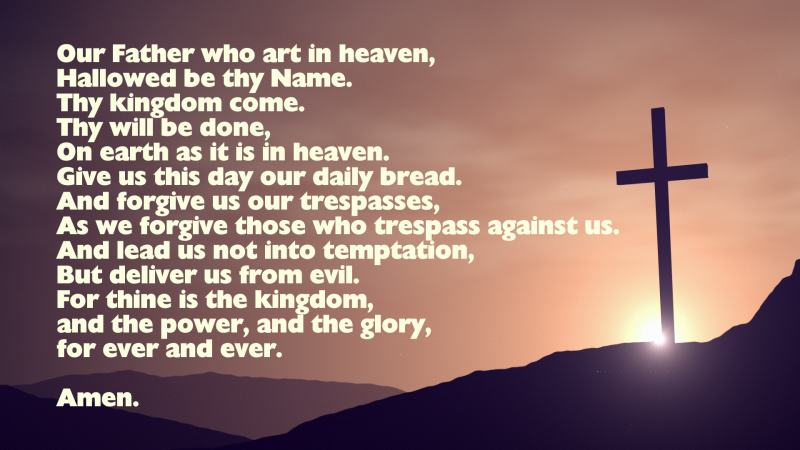The Lord's Prayer with image of a cross on a hill side