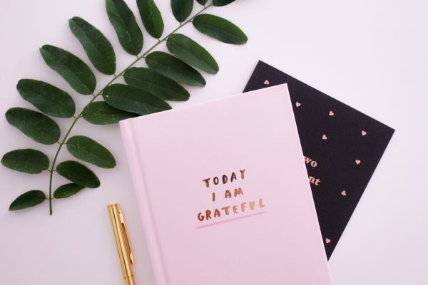 photo of a journal with the word grateful on
