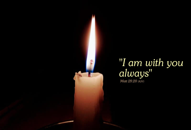 I am with you always words alongside a glowing candle